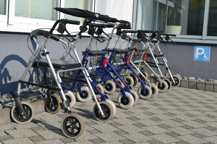 Walking aids for elderly include rollators like those pictured.